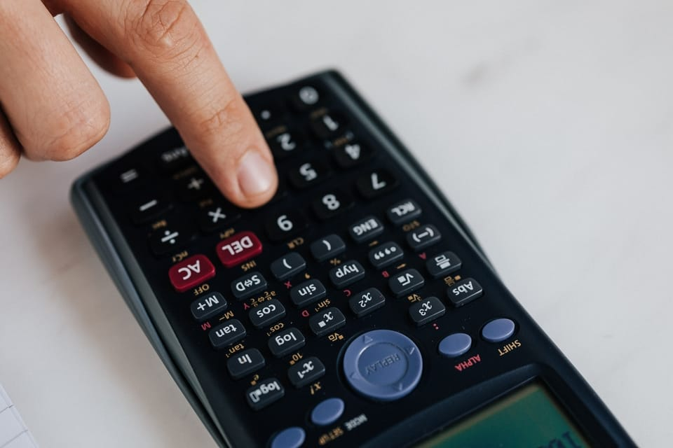 hand-pressing-button-on-calculator