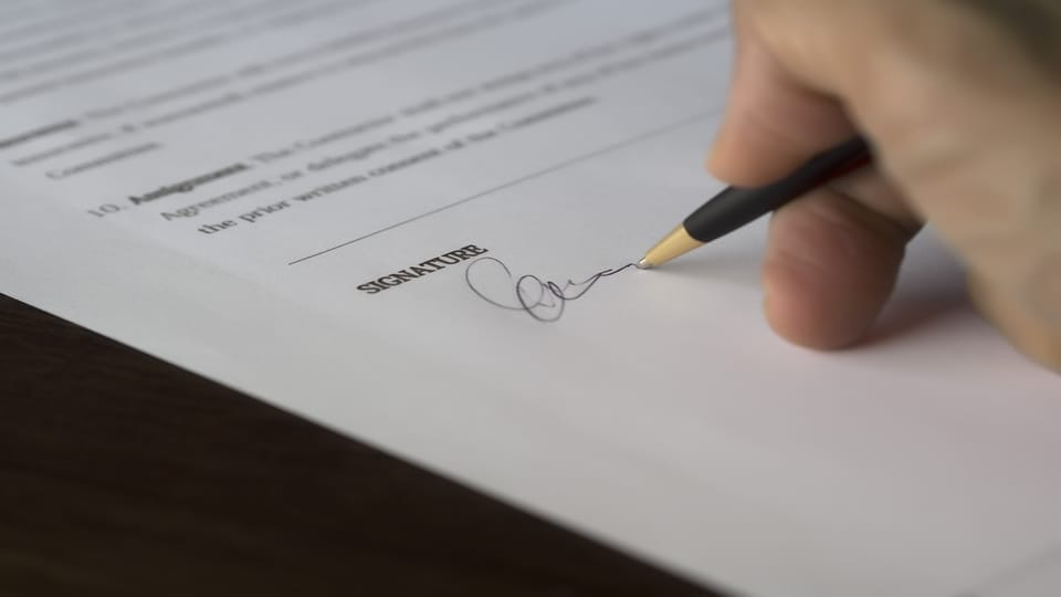 hand-signing-document